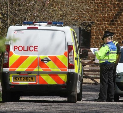 Police outside Donald Knight's home after he shot his wife, the family dog then killed himself