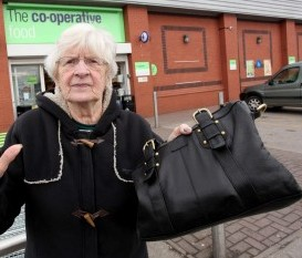 Margaret Leese with her handbag at the Co-op store, in Bucknall, Staffs., where she helped to catch a shoplifting thug