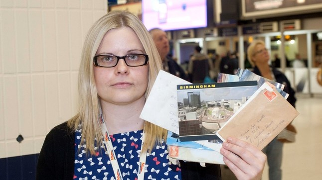 Nikee Clynes, Station support assistant for Network Rail holds some of the forgotten letters by spot where the post box used to be
