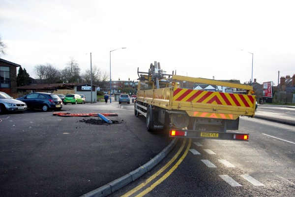 The lorry sits on the pavement after it is recovered from the crash scene
