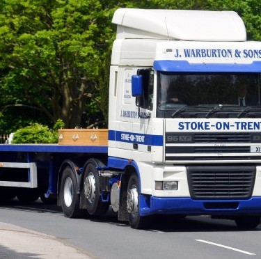 A lorry carries the coffin of retired HGV driver Bill Wood to his funeral