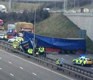 A lorry hold up traffic after plunging off the M42 flyover and landing on the M6 toll below