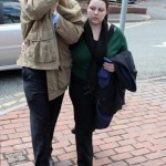 Mackay, 28, covers his face as he leaves court with his wife Stephanie