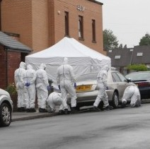 Police and bomb disposal experts around a mosque in Walsall, West Midlands, wehre the home-made bomb was left