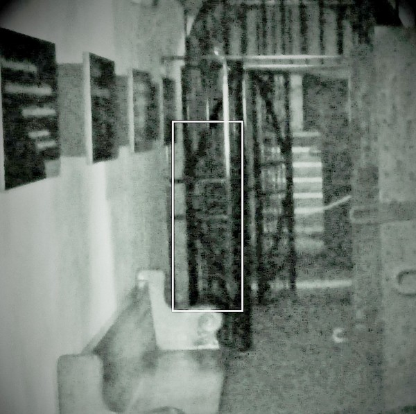 This creepy picture appears to show the image of a ghost wearing a hangman's hood in a former cell at the Galleries Of Justice in Nottingham