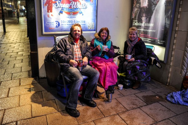 Jason Heath, 42, and his partner Glenis Mantell, 50, join fellow Daniel O'Donnell fan Linda Sneddon, 66, outside the Regent theatre in Stoke-On-Trent, England where they queued for tickets