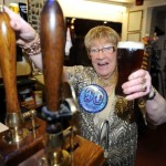 Joyce behind the bar at The Crown Inn in Lincoln where she still pulls in the punters and pints
