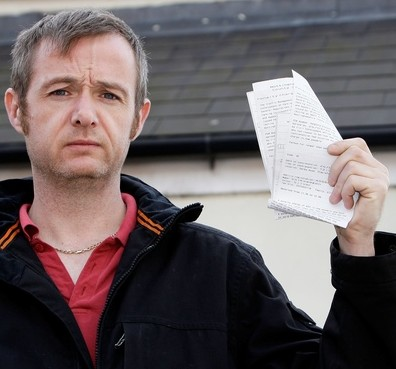 Steven Spencer, 38, outside his home in Stapleford, Nottingham where he's been left with £5,000 of parking fines for leaving his car outside his own home