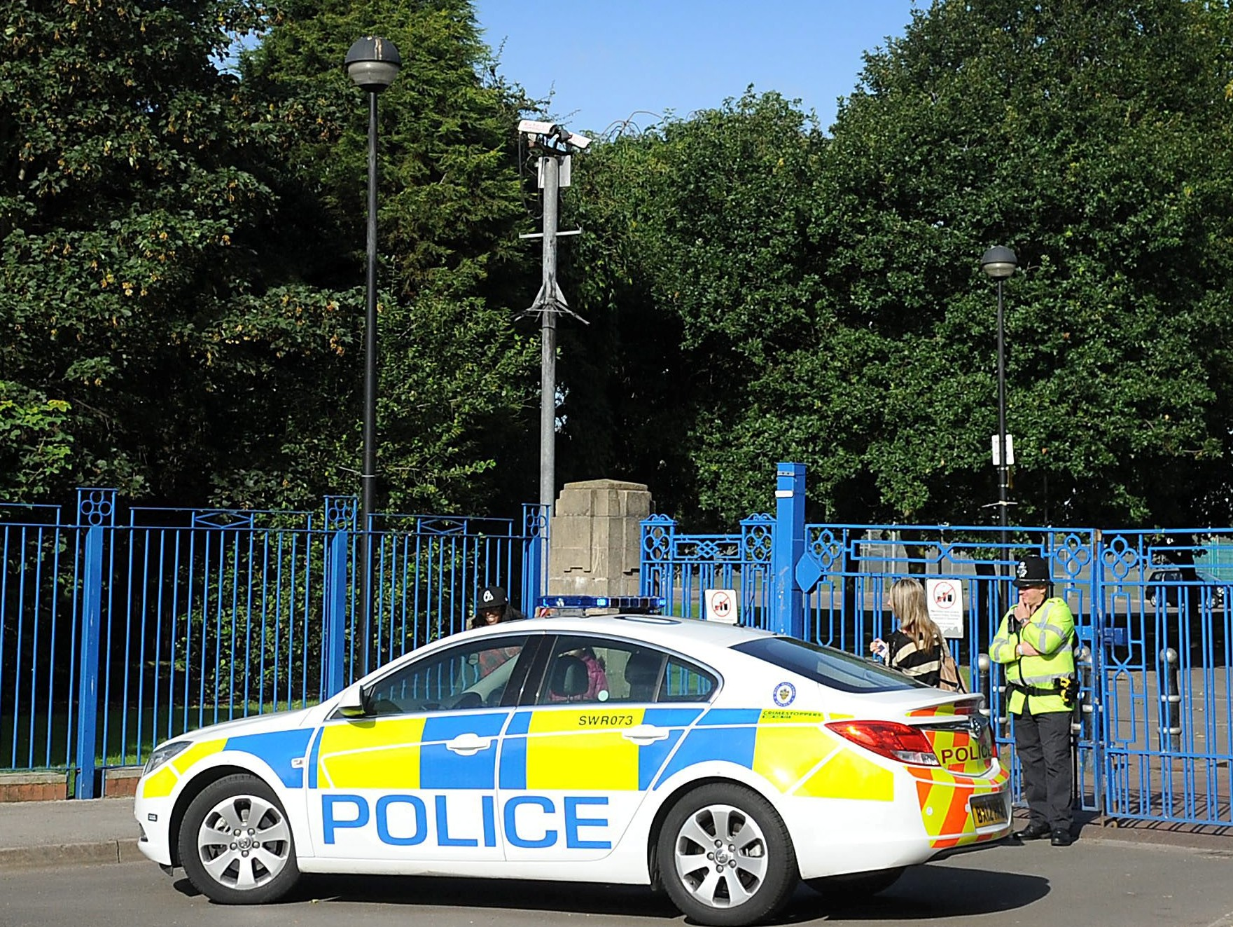 Police outside the park in Tipton, West Midlands, after Parkes mowed down his suspected love rival