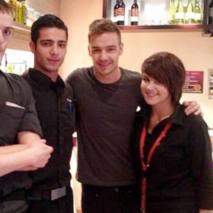 One Direction superstar Liam Payne (2nd right) poses with staff members at Pizza Hut in Wolverhampton where he was spotted with a mystery girl