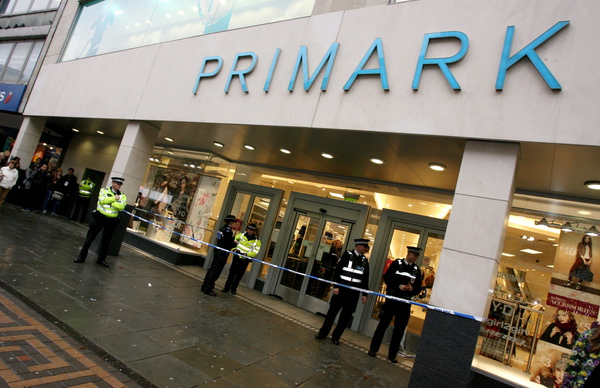 Police set up a cordon outside Primark in Nottingham after a boy fell over an escalator and landed on a rail