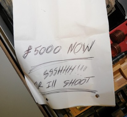 """The chilling note handed to a bank cashier which reads '£5,000 NOW, SHHH OR I'LL SHOOT"""""""