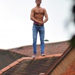 The man stands in his boots and jeans after running from a domestic incident
