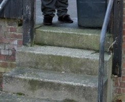 Outraged resident John Pulton next to the three steps that are considered 'too dangerous' for binmen to use