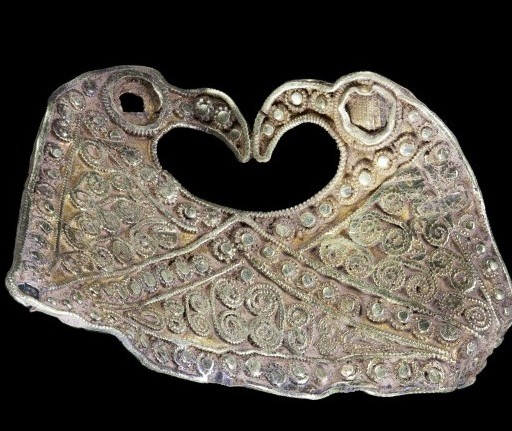 The golden Anglo Saxon artifact showing two lovebirds, part of the Staffordshire hoard