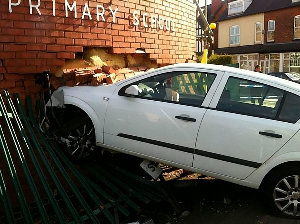 The Vauxhall Astra embedded in the wall of Springfield Primary School in Moseley, Birmingham