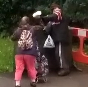 Vide shows the moment that a woman was caught throwing her shopping at a man then battering him with her trolley