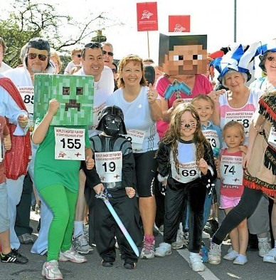 Runners set off in the worlds shortest fun run which is just 55 yards long