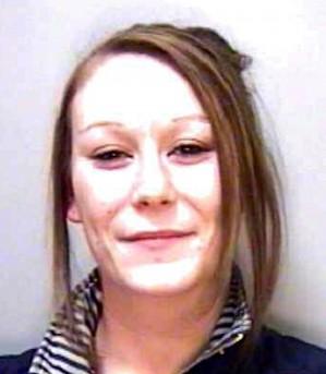 Georgina Hall, 22, smirks in her police mugshot