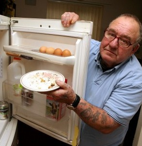 Dennis Dunstan with the plate of crumbs left bu burglars who even stole his mince pies