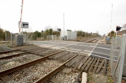 The level crossing near Evesham , Worcestershire where Jeremy Brown killed himself last September after a friend bombarded him with text messages posing as his ex-mistress