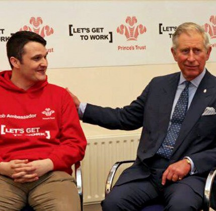Kirt Tabberer gets slapped on the back by Prince Charles in his role as a youth ambassador for the Princes Trust. He has since attacked a man and become jobless