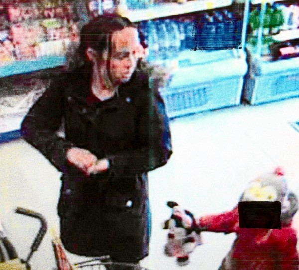 CCTV still capturing the moment a young mum stole an 84 year-olds pension in front of a young child