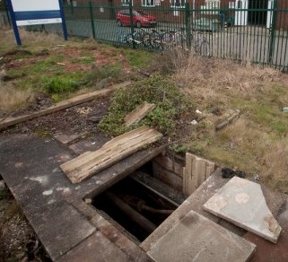 The entrance to the tunnel that lies across in the grounds of an old industrial estate from which thieves accessed the Warwickshire Wildlife Trust Re-Use centre