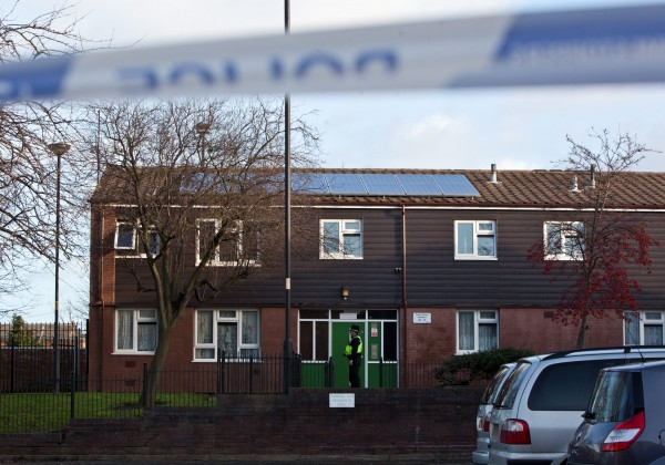 Police outside the house in Walsall where a man was killed in a fire on Christmas day