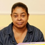 Sharon Jaddoo with washing powder that was mistaken for cocaine and one of the drums she sent it in along with rice and other goodies for her relative in Jamaica