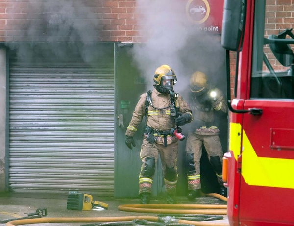 The Wilko store being attended to by fire crews when it was on fire by the 15-year-old work-experience schoolgirl