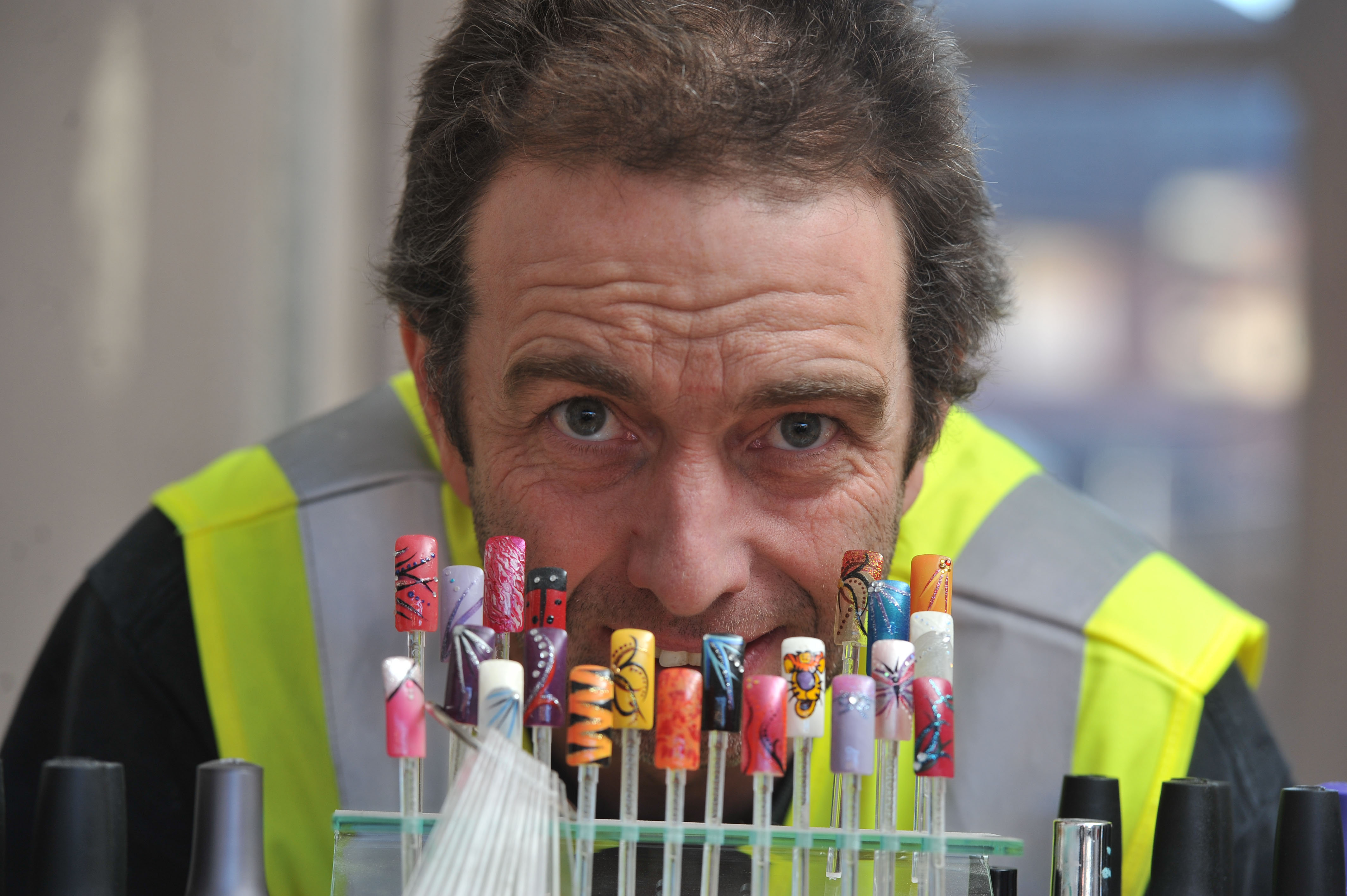Burly builder works with metal nails by day - and fingernails by ...