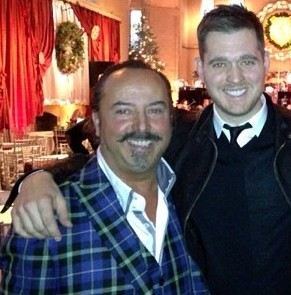 Kilt designer Mike Lemetti and his son Gianni with Michael Buble, centre