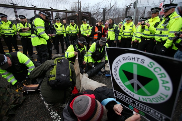 Trident protesters clash with police at Faslane Naval Base in East Dunbartonshire