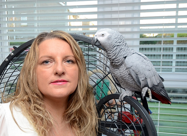 Michelle Cssie with her African grey parrot which has started mimicing the sounds of heavy machinery