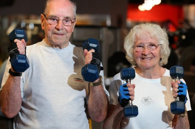 Exercise fanatics Bobby and Irene Simpson, lift weights together at the age of 80