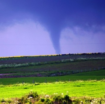 This dramatic photograph shows a tornado sweeping across Scottish fields near Stonehaven in Aberdeenshire