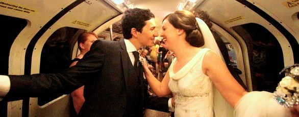 The love-struck couple stun commuters as they kiss on the train
