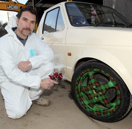 Body shop owner Tony Winters shows off a new spray painting service which provides tartan patterns - bringing an end to the age old joke about the apprentice being sent out for tartan paint