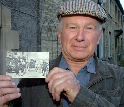 Keith Potter from Wiltshire with the postcard he received which was posted 100 years ago