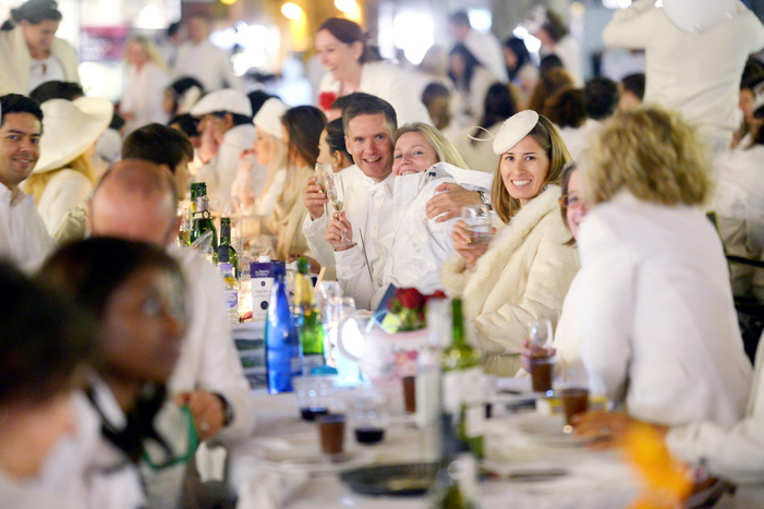 Revellers take part in Britain's first ever white-themed pop-up party