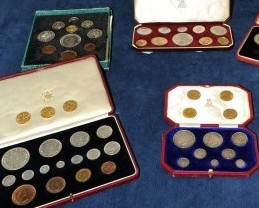 Paul Keen from the Plymouth Auction Rooms in Devon, with the historic coins which had been found hidden in a tool box