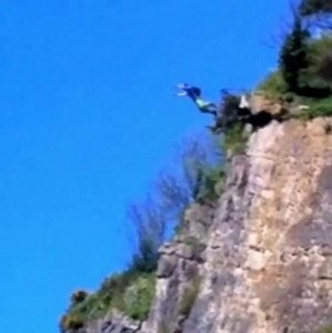 A base jumper leaps off Avon Gorge