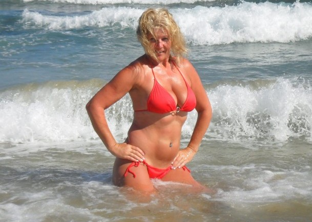 Carol Dunster in the Cornish surf, where she won Britain's annual beach babe competition