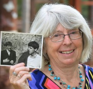 Sandra Woodruff, 66, with the underwear label she stole from the Beatles' hotel room and had signed