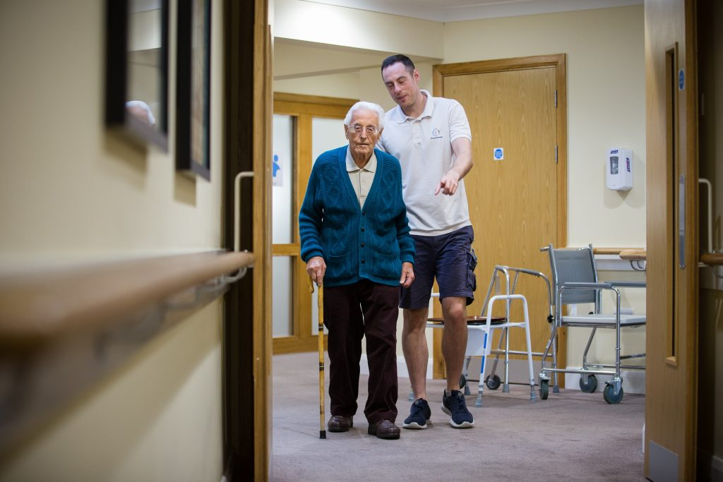 Raymond Longridge who is staying at Cooksons Court care home in Yeovil, pictured with physio Dan West.