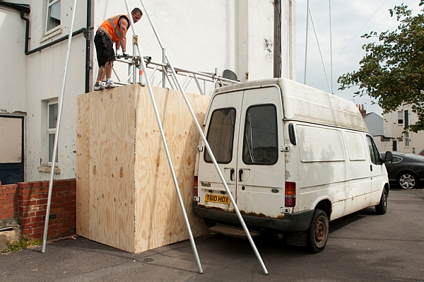 A workman puts up scaffolding around the Banksy spy mural in Cheltenham