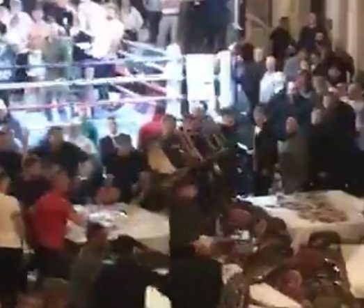 Grabs from the video showing a fight breaking out at a boxing match at Walsall Town Hall.