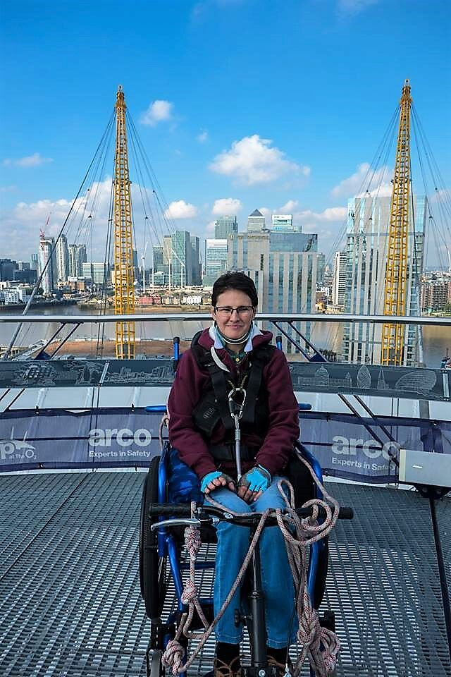 Collect Sarah Gearing on top of the O2 Arena about to absail down for charity.