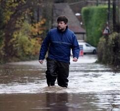 Jonny Goodman, 32, Bristol walking along flooded Old Bristol Road in Keynsham near Bristol today